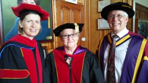 Greg greets ANU Chaplain Rev Dr Cynde North (left) and Rev Dr Nina Guner (center).