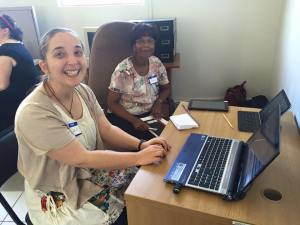 Helen Stocker (NTC-Manchester) and Anna Sibeko (NTC-South Africa) work to computerize the library system at SANU.