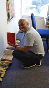 Pastor Hubert Tiger checks out Greg's books