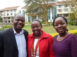 Pastor Gift Mtukwa (left) and his wife, Judy Mtukwa (right) bid farewell to Lucy Kimani.