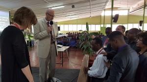 Rev Evans Katanga kneels as we pray for him.